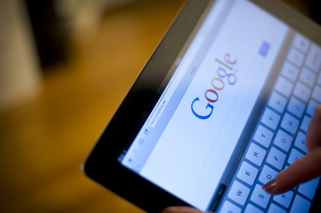 St.Helens, England - January 15th 2012: iPad2 in females hands displaying google search engine page. Google is one of the biggest search engines in the world. iPad2 was launched in March 2011.