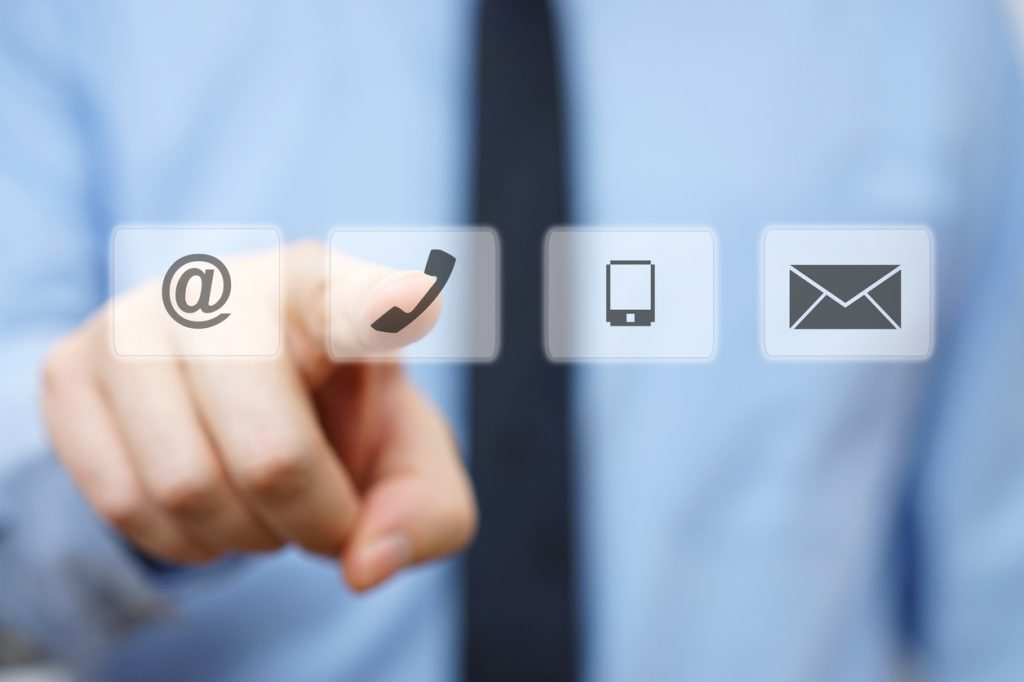businessman pressing phone button, company identification icons