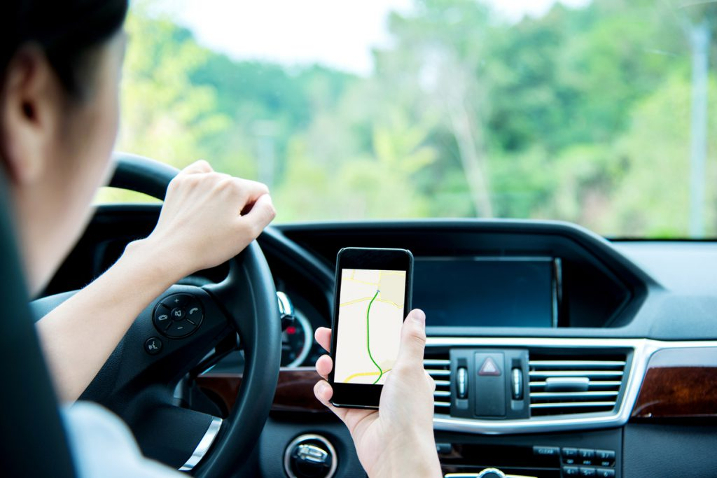 Woman using smart phone while driving