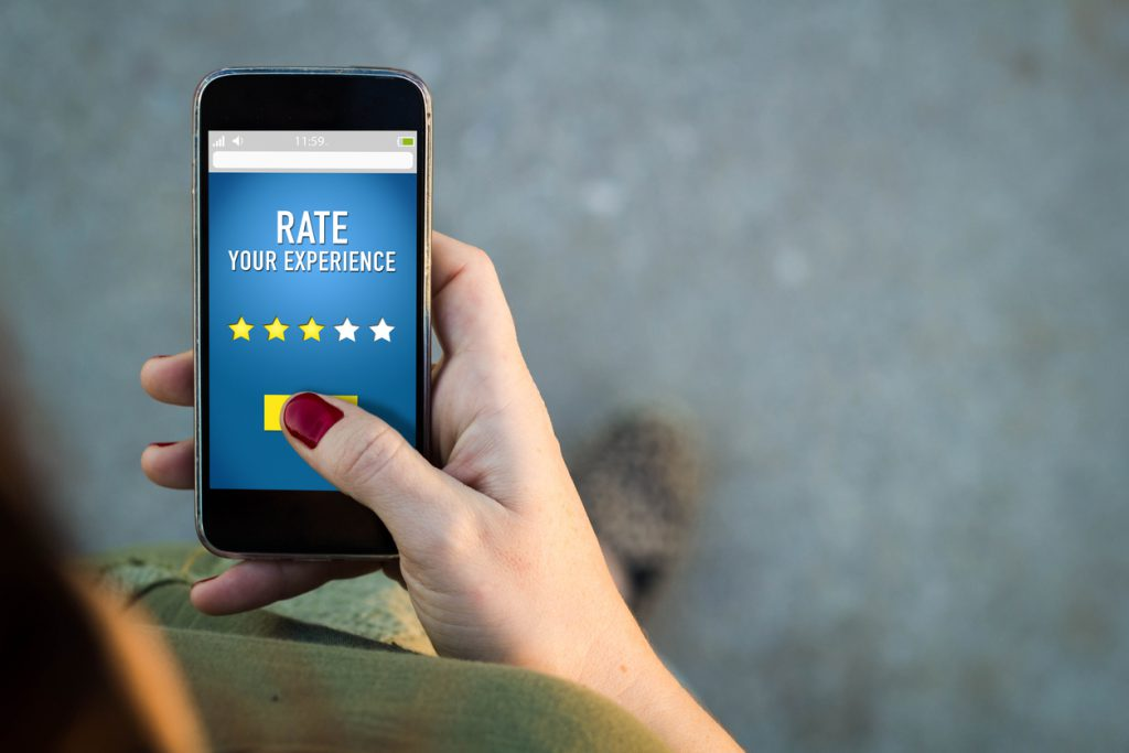 Woman walking smartphone rating on a web