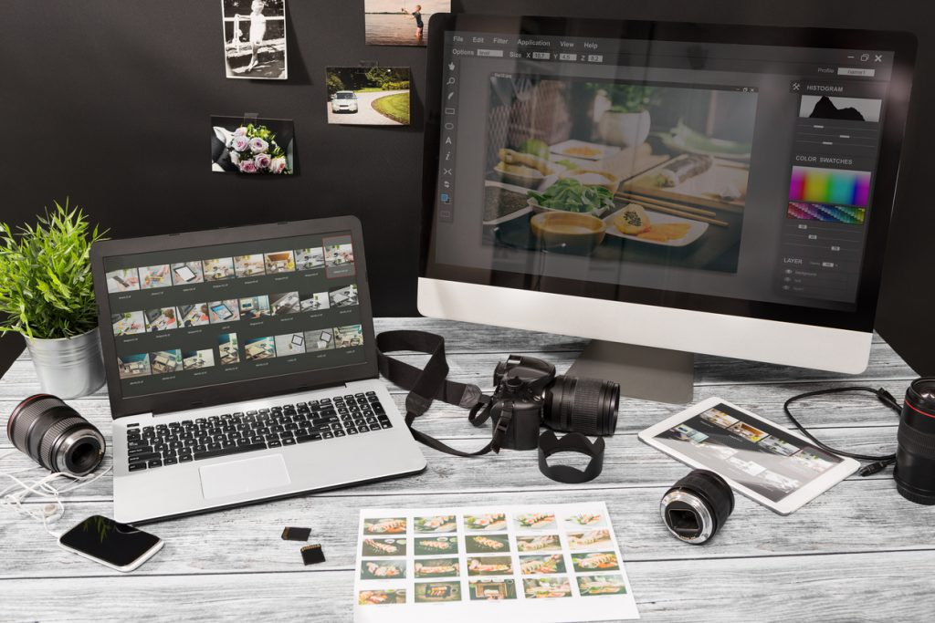 Photographers computer with photo edit programs.