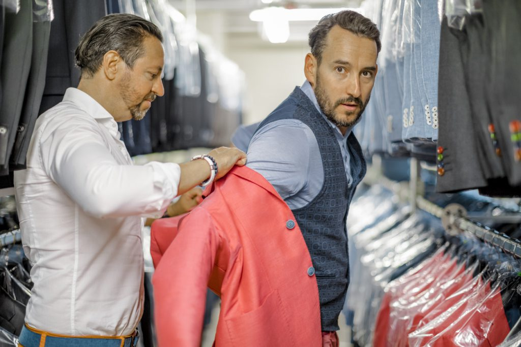 A personal stylist helping his customer