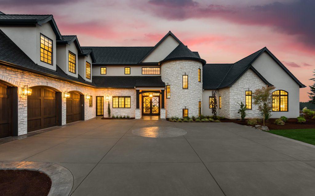 Stunning luxury home exterior at sunset