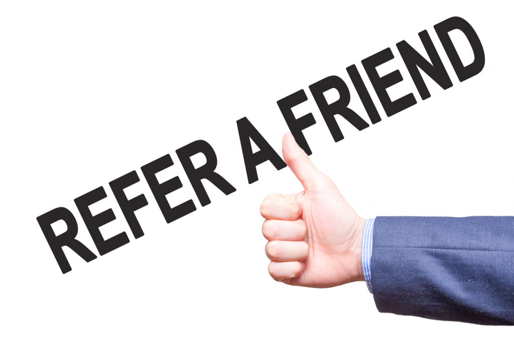 Manthumbs up. Sign REFER A FRIEND . Business, technology, internet concept. Stock Photo - Stock image
