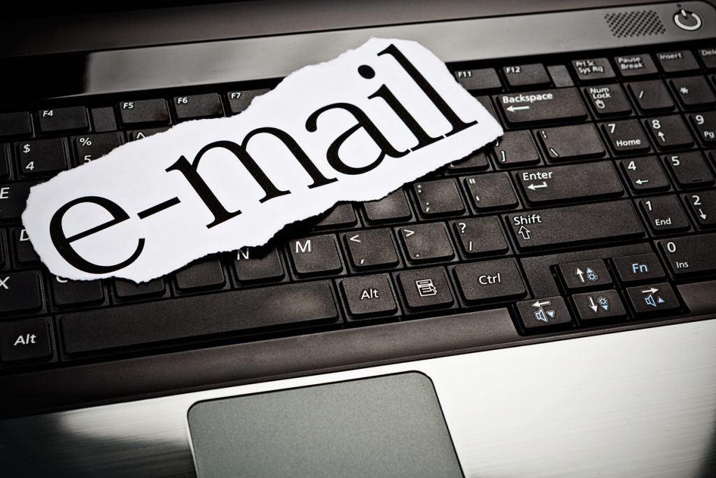 e-mail sign resting on laptop keyboard