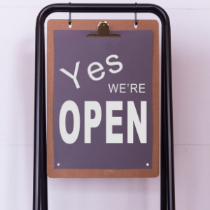 Customer service sign showing business is open
